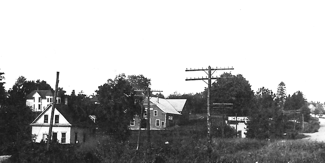 The first Williams Bay post office was located in Edward and Marie Williams home show above. (Small white house lower left)